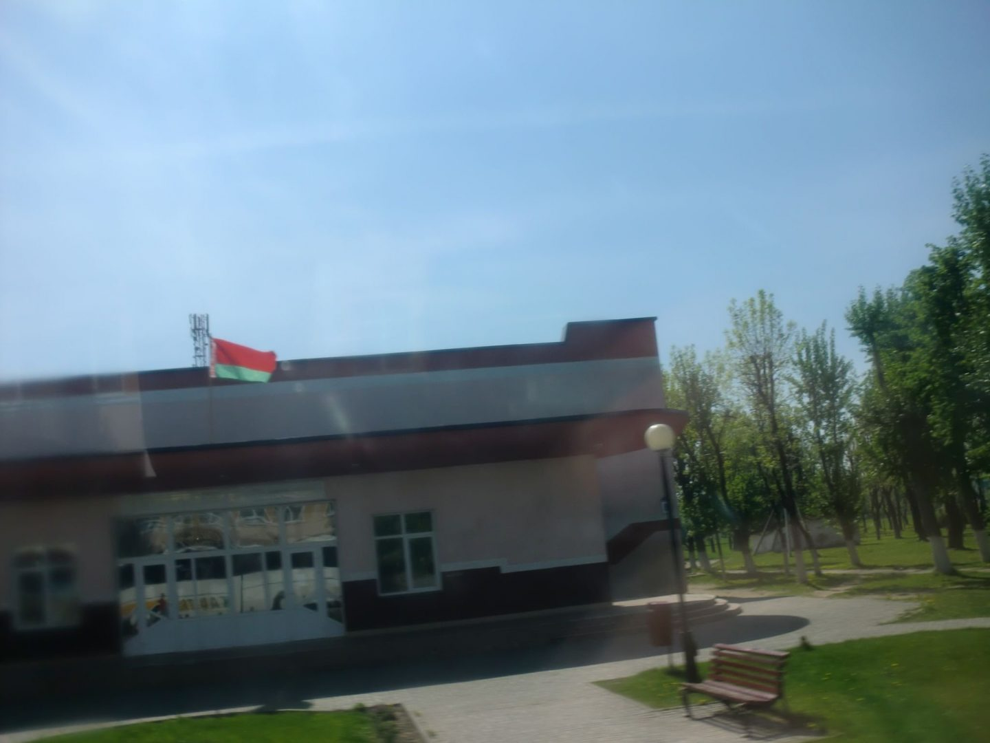 From Vilnius to Minsk by bus - A house with trees in the background