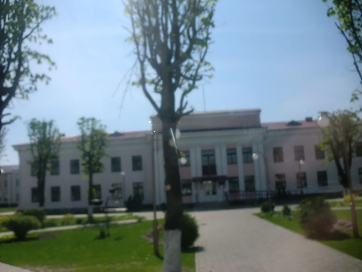 From Vilnius to Minsk by bus- A house with trees in the background - House